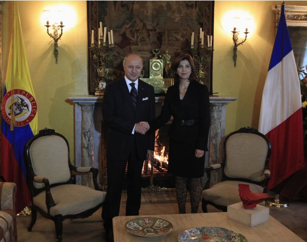 France's Foreign Affairs Minister Fabius and Colombia's Foreign Minister Holguin shake hands before a bilateral meeting at San Carlos Palace in Bogota