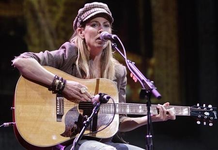 Sheryl Crow performs for Starbucks shareholders at the coffee company's annual meeting in Seattle