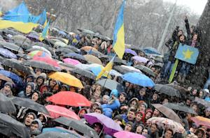 Some 15,000 people holding umbrellas attend a rally…