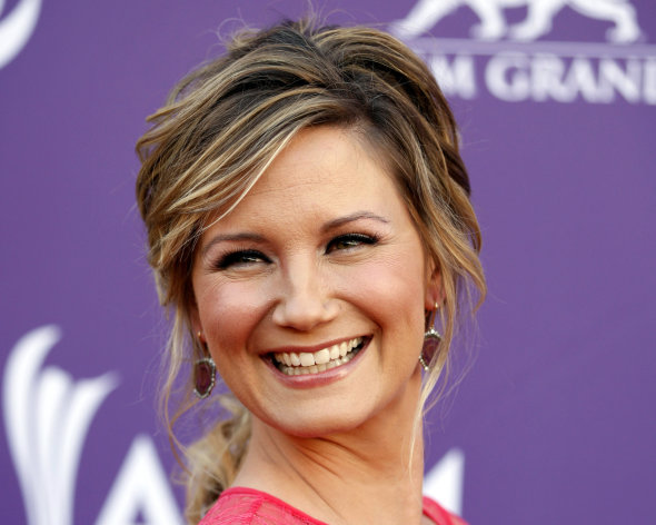FILE - This April 1, 2012 file photo shows country singer Jennifer Nettles, of musical group Sugarland, arriving at the 47th Annual Academy of Country Music Awards in Las Vegas. The Grammy-winning country singer and and husband Justin Miller announced the birth of their son, Magnus Hamilton Miller on Thursday, Dec. 6, 2012. (AP Photo/Isaac Brekken, file)