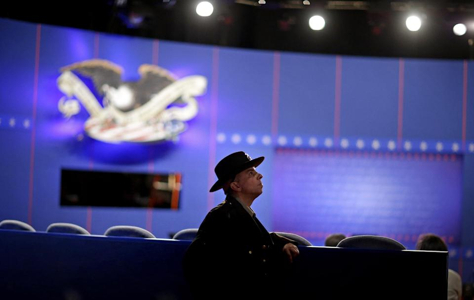Hofstra Public Safety officer Ronald Nardo stands guard off the set of Tuesday's presidential debate between Republican presidential candidate, former Massachusetts Gov. Mitt Romney and President Barack Obama, Monday, Oct. 15, 2012, at Hofstra University in Hempstead, N.Y. (AP Photo/David Goldman)