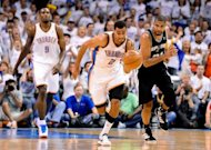 Oklahoma City Thunder&#39;s Thabo Sefolosha takes the ball down the court during game six of the NBA Western Conference finals on June 6. The Thunder won their fourth straight game to reach the NBA finals with a 107-99 victory over the Spurs