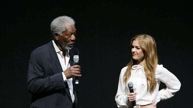 """Morgan Freeman and Isla Fisher, cast members in the upcoming film """"Now You See Me"""" at Lionsgate Presentation at 2013 CinemaCon, on Thursday, April, 18th, 2013 in Las Vegas. (Photo by Eric Charbonneau/Invision for Lionsgate/AP Images)"""