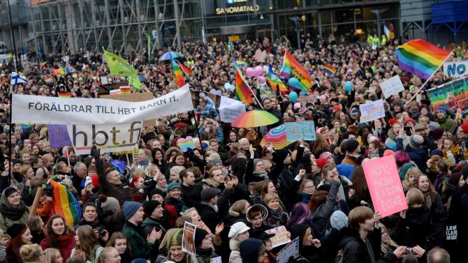 Supporters of same-sex marriage gather outside the Finnish Parliament in Helsinki