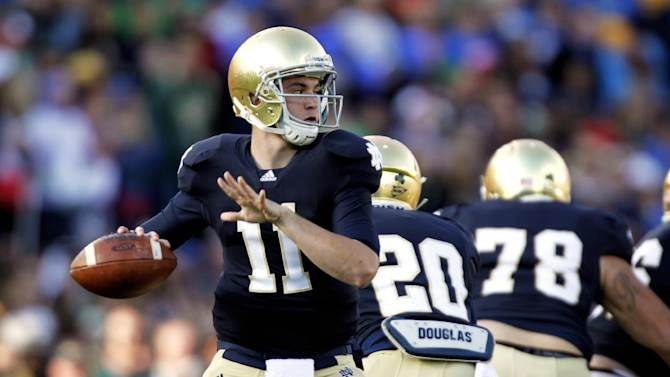 Notre Dame quarterback Tommy Rees throws against Navy during the first half of an NCAA college football game in South Bend, Ind., Saturday, Oct. 29, 2011. (AP Photo/Michael Conroy)