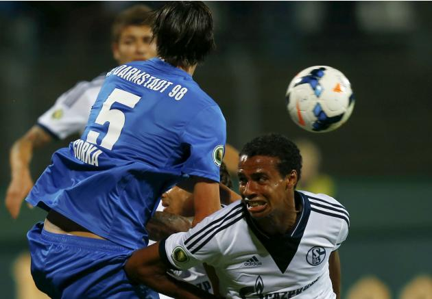 Schalke's Matip challenges Gorka of Darmstadt 98 during their German soccer cup second round match in Darmstadt