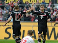 Bayern Munich's Thomas Mueller (right) celebrates scoring with teammate Arjen Robben during the Bundesliga match against 1. FC Cologne in Cologne on Saturday. Mueller has said Bayern Munich must break their four-match losing streak at the hands of German champions Borussia Dortmund when the teams meet in Saturday's German Cup final