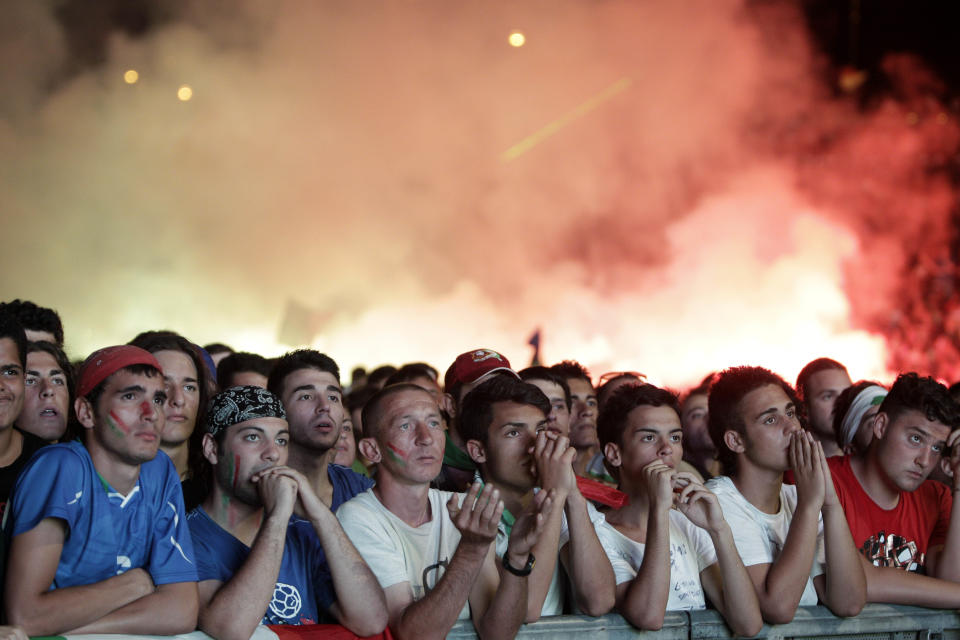 Italian fans react at the Circus Maximus in Rome, during the Euro 2012 soccer championship final match between Italy and Spain, Sunday, July 1, 2012. (AP Photo/Riccardo De Luca)