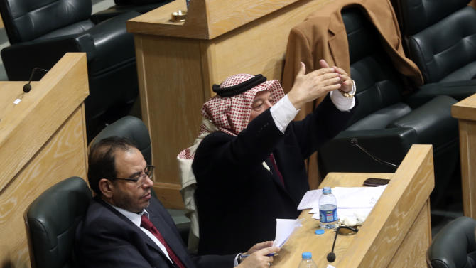 Jordanian lawmakers attend the second day of a heated debate on the U.S. push for a peace deal between Israelis and Palestinians, under the domed parliament chamber in the capital, Amman, Jordan, Tuesday, Feb. 4, 2014. The kingdom is already home to the largest Palestinian population outside the West Bank and Gaza Strip, and Jordanian lawmakers and others fear the Palestinians will be coerced into an accord that gives up land and leads to a new influx of refugees into Jordan. (AP Photo)