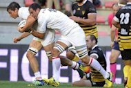 Toulouse's Sylavain Nicolas (L) and Gregory Lamboley (C) break away from Mont-De-Marsan's players during the French Top 14 rugby union match at the Ernest Wallon Stadium in Toulouse, southern France. Toulouse overcame a 19-17 half-time deficit to beat promoted Mont-de-Marsan 37-22