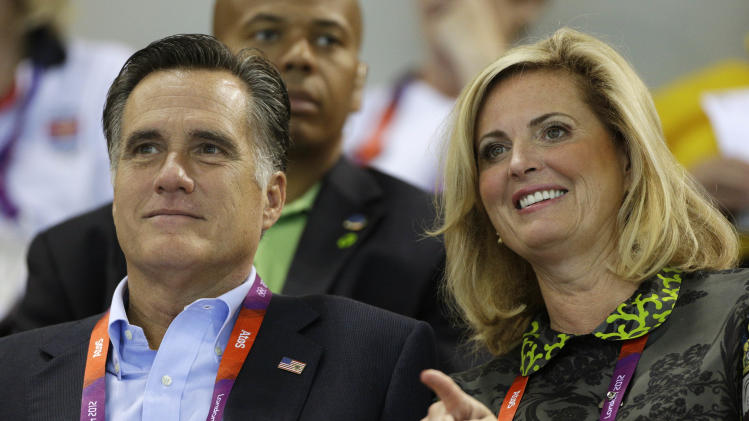 U.S. Republican presidential candidate Mitt Romney, left, and his wife Ann watch swimming heats at the Aquatics Centre in the Olympic Park during the 2012 Summer Olympics in London, Saturday, July 28, 2012. (AP Photo/Michael Sohn)