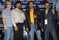 Boxers Juan Manuel Marquez, second from right, and Manny Pacquiao, second from left, pose for pictures with their trainers, Freddie Roach, left, and Ignacio Beristain during a news conference in New York, Wednesday, Sept. 19, 2012. The boxers are promoting their fourth fight, scheduled for Dec. 8, 2012 in Las Vegas. (AP Photo/Seth Wenig)