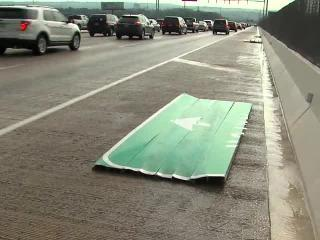 Highway sign falls during high winds