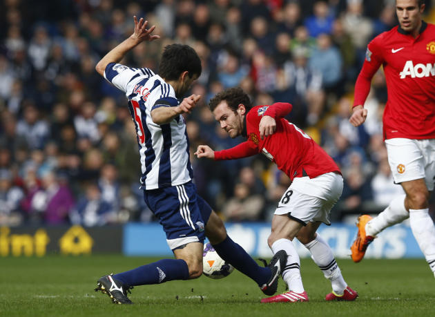 West Bromwich Albion's Yacob fouls Manchester United's Mata during their English Premier League soccer match at The Hawthorns in West Bromwich