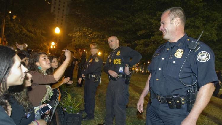 A protestor yells at a police officer as Woodruff Park is sealed off to arrest those refusing to leave after Mayor Kasim Reed revoked his executive order allowing the Occupy Atlanta protestors to camp out in Woodruff Park Tuesday, Oct. 25, 2011 in Atlanta. (AP Photo/David Goldman)