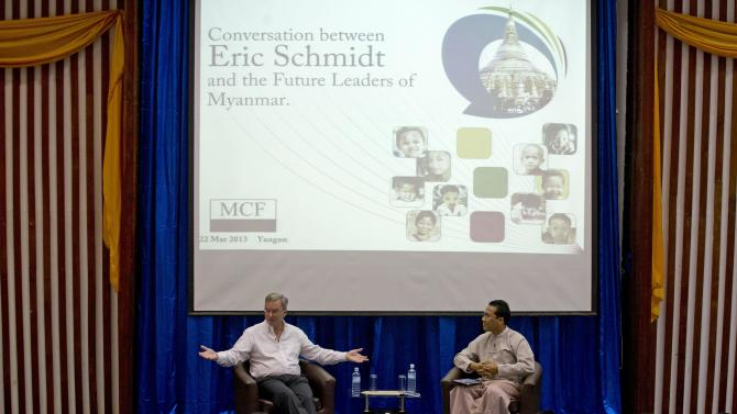 Google Executive Chairman Eric Schmidt, left, gestures during  an interactive session with group of students at a technical university in Yangon, Myanmar, Friday, March 22, 2013. Schmidt on Friday urged Myanmar's government to allow private businesses to develop the country's woeful telecommunications infrastructure, emphasizing the importance of competition and free speech. (AP Photo/Gemunu Amarasinghe)