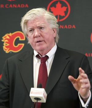 Brian Burke, Calgary Flames' president of hockey operations, announces the firing of GM Jay Feaster and assistant GM John Weisbrod at a press conference in Calgary, Alta., Thursday, December 12, 2013. THE CANADIAN PRESS/Larry MacDougal