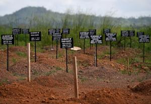 Tombstones at a cemetery at the Kenama Ebola treatment …