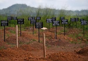 Tombstones at a cemetery at the Kenama Ebola treatment…