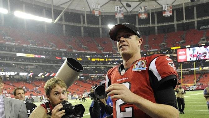 Atlanta Falcons quarterback Matt Ryan (2) walks off the field after the second half of an NFL football game against the New York Giants, Sunday, Dec. 16, 2012, in Atlanta. The Falcons won 34-0. (AP Photo/John Amis)