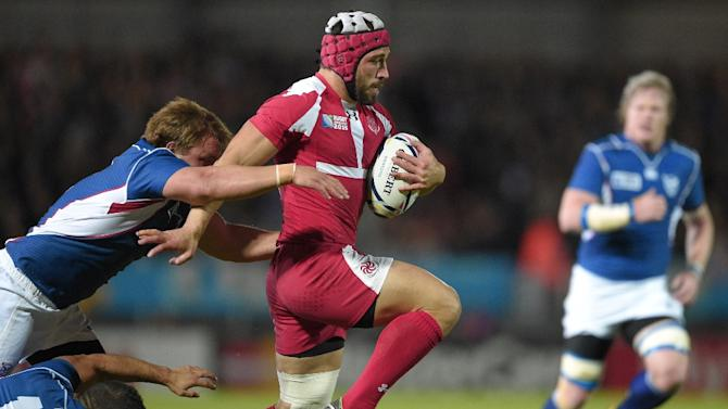 Georgia's centre Merab Sharikadze (C) runs with the ball during a Pool C match of the 2015 Rugby World Cup between Namibia and Georgia at Sandy Park in Exeter, southwest England, on October 7, 2015