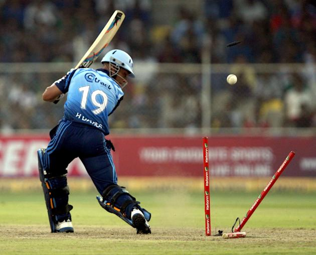 H Davids of Titans gets bowled during the CLT20 match between Titans and Trinidad & Tobago at Sardar Patel Stadium, Motera in Ahmedabad on Sept. 30, 2013. (Photo: IANS)