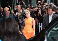 US singer Lady Gaga (C) is greated by fans as she arrives at her hotel in Auckland on June 5, 2012. Lady Gaga suffered concussion when a dancer accidentally hit her on the head with a metal pole during her final New Zealand show, reports said Monday