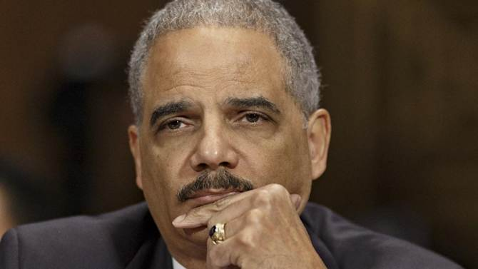 Attorney General Eric Holder listens on Capitol Hill in Washington, Wednesday, Jan. 29, 2014, as he testifies before the Senate Judiciary Committee oversight hearing on the Justice Department. (AP Photo/J. Scott Applewhite)