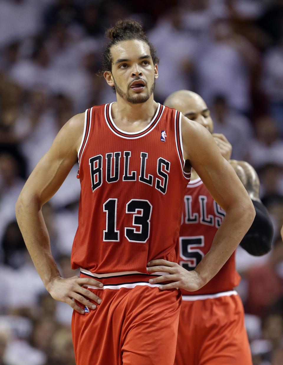Chicago Bulls' Joakim Noah (13) walks on the court during the first half of Game 5 of the Bulls' NBA basketball Eastern Conference semifinal against the Miami Heat, Wednesday, May 15, 2013, in Miami. The Heat defeated the Bulls 94-91, and won the series. (AP Photo/Wilfredo Lee)