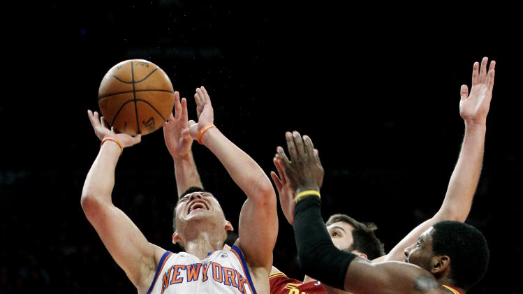 New York Knicks guard Jeremy Lin (17) goes up against Cleveland Cavaliers forward Omri Casspi (36) and guard Kyrie Irving (2) in the first half of their NBA basketball game at New York's Madison Square Garden, Wednesday, Feb. 29, 2012. (AP Photo/Kathy Willens)