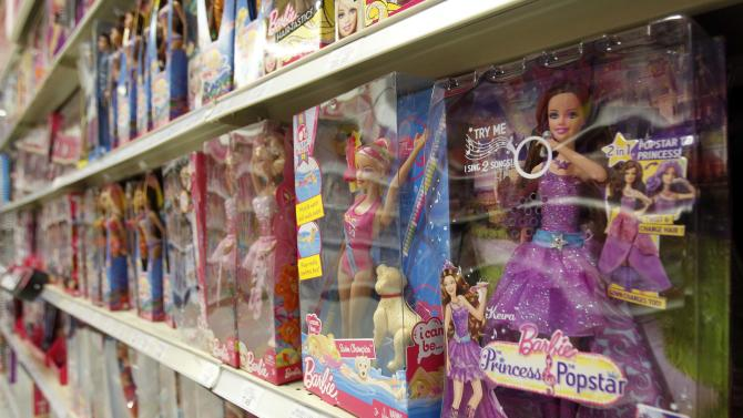 FILE- In this July 16, 2012, file photo, Barbie products are displayed at a local toy store in Hialeah, Fla. Mattel, the biggest U.S. toy maker,reports quarterly earns on Wednesday, July 17, 2013. (AP Photo/Alan Diaz, File)