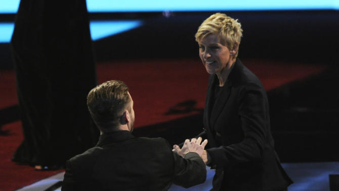 Justin Timberlake, left, congratulates Ellen DeGeneres, winner of the favorite daytime TV host award, as she walks on stage at the 40th annual People's Choice Awards at the Nokia Theatre L.A. Live on Wednesday, Jan. 8, 2014, in Los Angeles. (Photo by Chris Pizzello/Invision/AP)