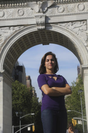 """In this Aug. 22, 2013, photo, New York University junior Christina Isnardi poses for a portrait in New York's Washington Square Park. Isnardi and a fellow student started the campus petition that asks the school to refrain from posting unpaid internships offered by for-profit businesses. As a summer intern on a movie project, her responsibilities included securing the perimeter on closed sets and guarding expensive equipment. """"I didn't get any educational benefit,"""" she said. """"I was doing the work of an employee."""" (AP Photo/Mary Altaffer)"""