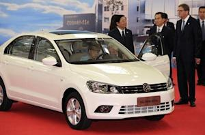 German Chancellor Merkel sits in an All New Jetta as she visits the FAW-Volkswagen production plant, in Chengdu