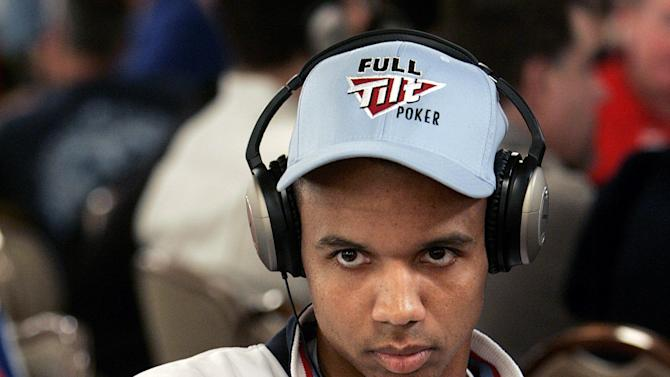 FILE - This is a Saturday, July,  9, 2005  file photo of Phil Ivey  as he waits for the next deal  in the World Series of Poker at the Rio Hotel and Casino in Las Vegas.  A casino group has accused U.S. professional poker star Phil Ivey of cheating at baccarat and says the alleged scam means they don't have to pay his claimed multimillion dollar winnings. The Genting Group said in court papers filed Tuesday  May 14, 2013 that Ivey and an accomplice used an elaborate scam to run up roughly 7.8 million pounds ($11.9 million) in tainted winnings that will not be honored (AP Photo/Joe Cavaretta, File)
