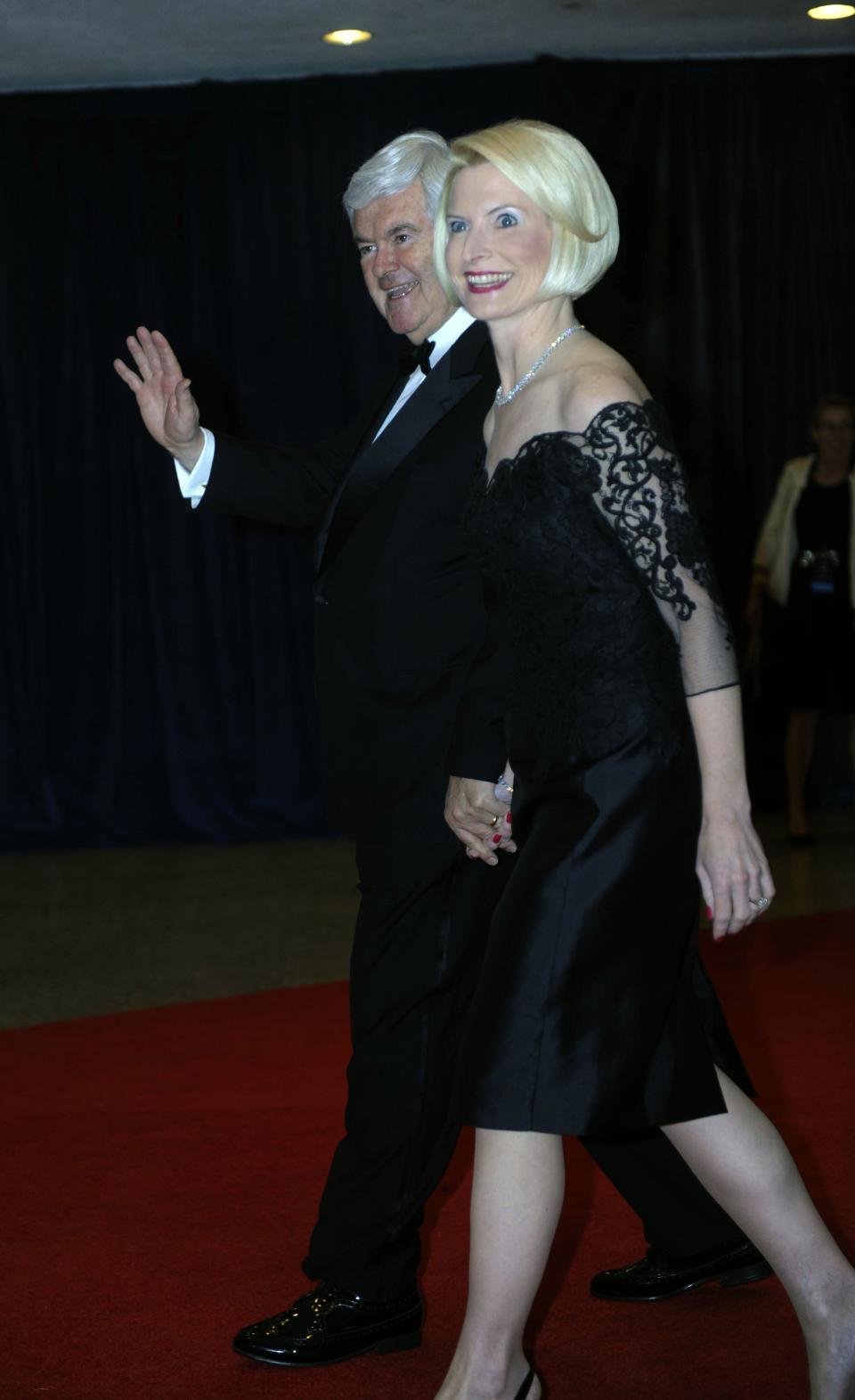 Newt and Callista Gingrich arrive at the White House Correspondents' Association Dinner on Saturday, April 28, 2012 in Washington.  (AP Photo/Kevin Wolf)