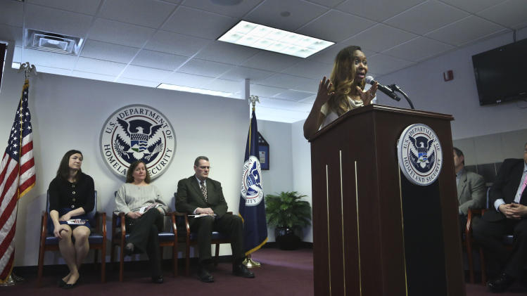 "Immaculee Ilibagiza speaks during the U.S. Citizenship and Immigration Services (USCIS) naturalization ceremony on Wednesday, April 17, 2013 in New York.  Ilibagiza, addressed fellow immigrants with her story of hiding in a 3-by-4 foot bathroom with seven other women and girls before fleeing the 1994 Rwandan genocide, which claimed more than 500,000 lives. ""Everybody I left behind in Rwanda was killed,"" she said.  (AP Photo/Bebeto Matthews)"