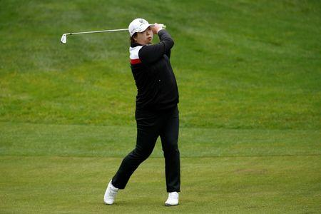 Top China golfer Feng not to allow Zika fears ruin Rio dream