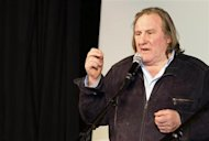 Actor Gerard Depardieu delivers a speech during a ceremony to open the restored &quot;Illusion&quot; cinema in Moscow February 22, 2013. REUTERS/Ivan Burnyashev