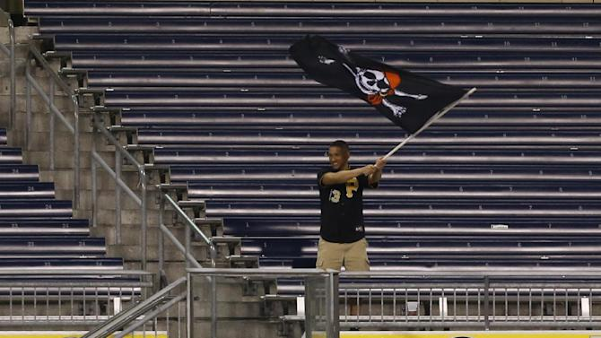 A Pittsburgh Pirates fan waves a Jolly Roger flag in the center field bleachers in the ninth inning of the baseball game between the Pittsburgh Pirates and the Chicago Cubs on Monday, April 20, 2015, in Pittsburgh.  (AP Photo/Keith Srakocic)