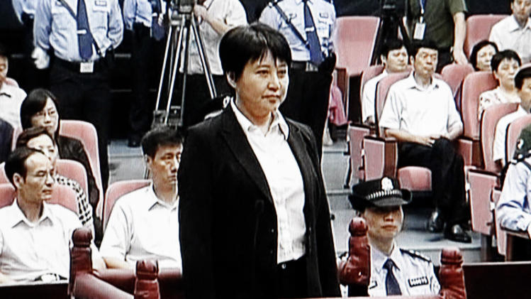 FILE - In this Aug. 9, 2012 file video image taken from CCTV, Gu Kailai, center, the wife of disgraced politician Bo Xilai, stands during her trial in the Hefei Intermediate People's Court in Hefei in eastern China's Anhui province.  The fallen Chinese politician's wife who confessed to killing a British businessman is due to hear the verdict Monday, Aug. 20, 2012,  in her murder trial and Communist Party leaders might have decided against a death penalty for fear it could incite public sympathy for her.   (AP Photo/CCTV via APTN, File) CHINA OUT, TV OUT