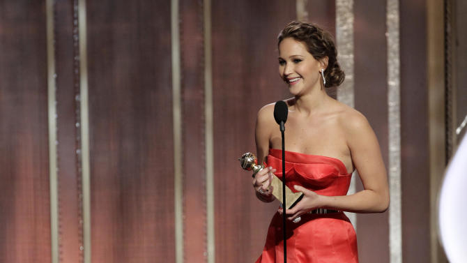 """This image released by NBC shows actress Jennifer Lawrence with her award for best actress in in a motion picture comedy or musical for her role in """"Silver Linings Playbook"""" during the 70th Annual Golden Globe Awards at the Beverly Hilton Hotel on Jan. 13, 2013, in Beverly Hills, Calif. (AP Photo/NBC, Paul Drinkwater)"""