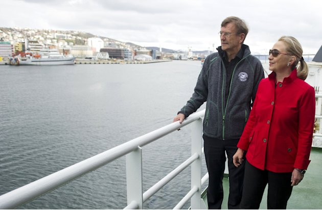 US Secretary of State Hillary Rodham Clinton, right, speaks with Jarle Aarbakke, Rector of the University of Tromso, aboard the Arctic Research Vessel Helmer Hanssen during a boat tour of the coastlin