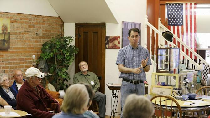 Republican presidential candidate, Wisconsin Gov. Scott Walker speaks during a meet and greet with local residents, Thursday, Aug. 27, 2015, in Greenfield, Iowa. (AP Photo/Charlie Neibergall)