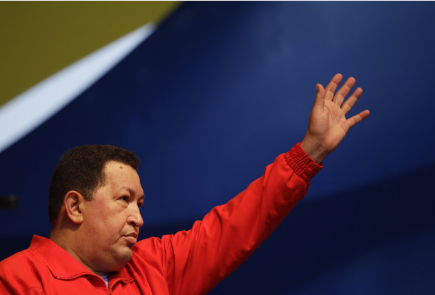 Venezuela's President Hugo Chavez waves to supporters during a campaign rally in the Antimano neighborhood of Caracas, Venezuela, Friday, Aug. 3, 2012. Venezuela's presidential election is scheduled f