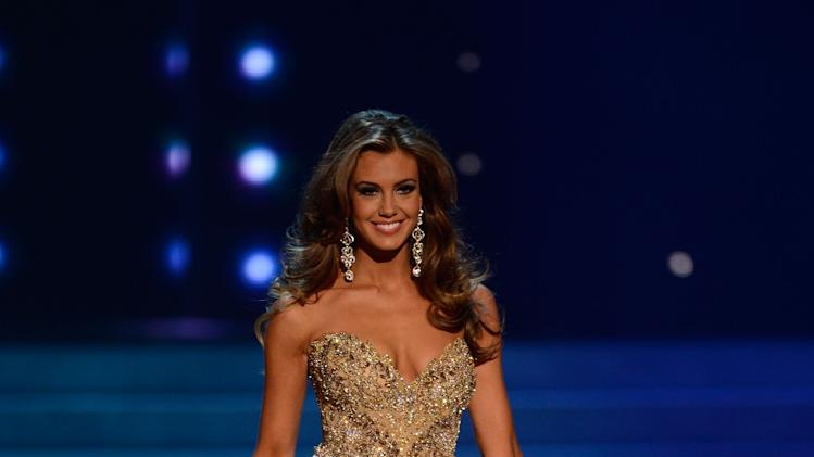 Miss Connecticut Erin Brady walks the runway during the evening gown competition of the Miss USA 2013 pageant, Sunday, June 16, 2013, in Las Vegas. Erin Brady of South Glastonbury, Conn., won the beauty pageant. (AP Photo/Jeff Bottari)