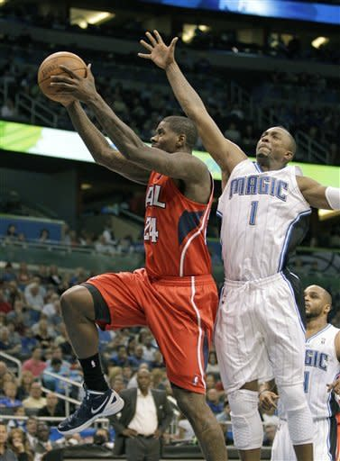 Hawks shoot way past Howard-less Magic 109-81