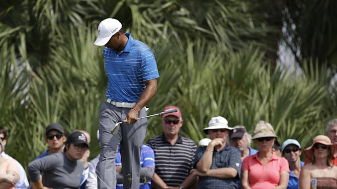 Tiger Woods kicks the ground after over hitting on the eighth green during the first round of the Honda Classic golf tournament, Thursday, Feb. 27, 2014, in Palm Beach Gardens, Fla