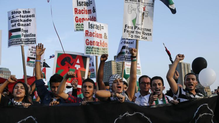 Demonstrators march across the Brooklyn Bridge during a pro-Palestinian rally in Manhattan, New York