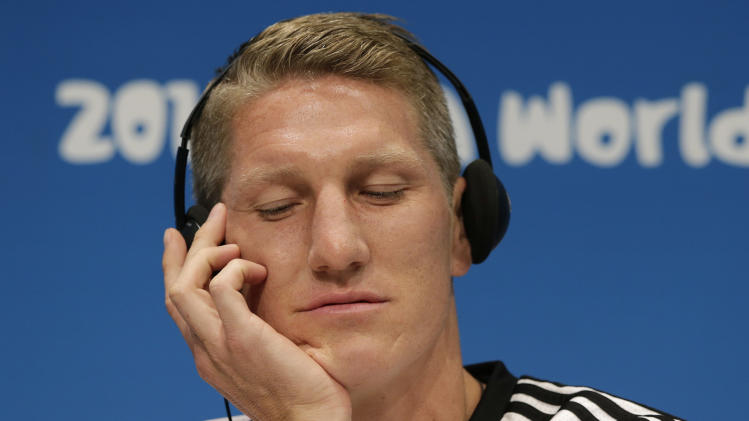 German national soccer player Bastian Schweinsteiger closes his eyes as he listens to questions of journalists during a news conference one day before the World Cup final soccer match between Germany and Argentina in Maracana stadium in Rio de Janeiro, Brazil, Saturday, July 12, 2014. (AP Photo/Matthias Schrader)